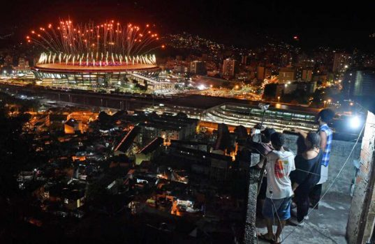 Onlookers watch the Rio Games' opening ceremony from the city's favelas.